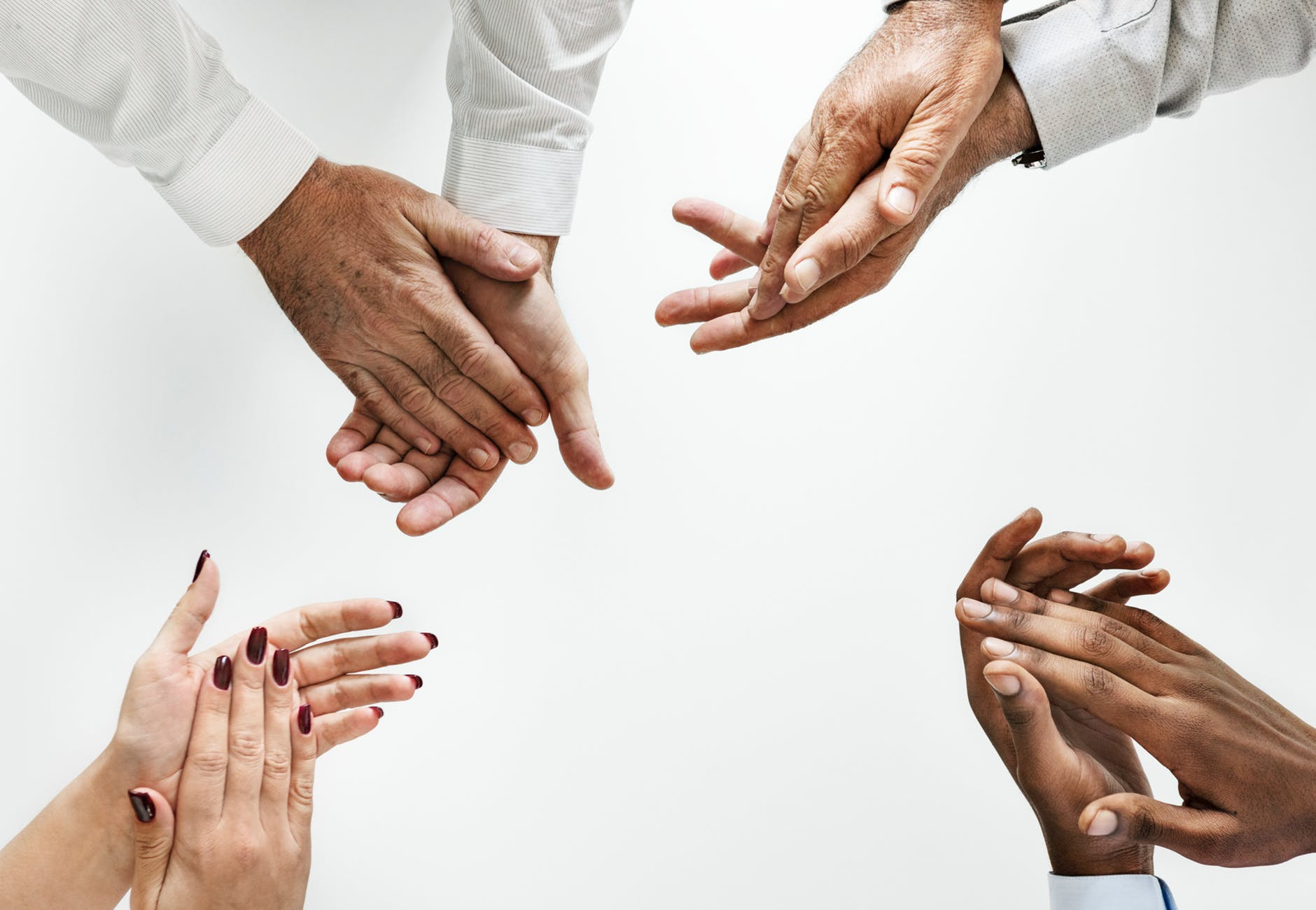 four people showing clap hand gestures